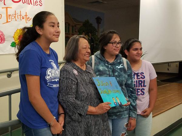 Karime Martinez, Rosie Castro, Diamond Gonzales, Natalie Ornelas. Castro holds a portrait of her sons, Joaquin and Julián, created by the three girls.