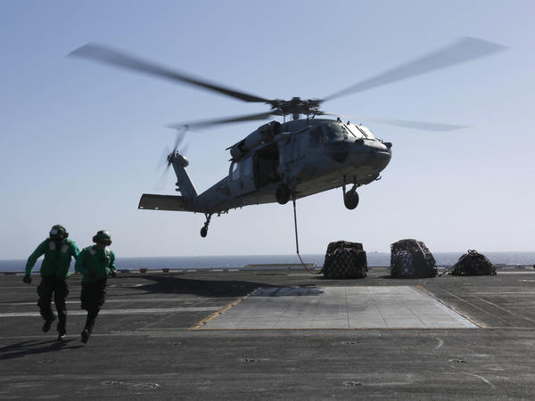 An MH-60S Sea Hawk helicopter takes off from the aircraft carrier USS Abraham Lincoln in the Red Sea. The Abraham Lincoln Carrier Strike Group was recently deployed to the U.S. Central Command area of responsibility as tensions between the U.S. and Iran escalate. On Monday, the State Department ordered additional troops to the Middle East.
