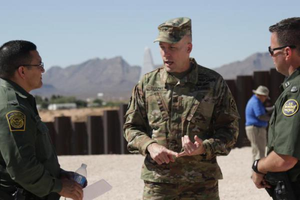 Army Brig. Gen. Walter Duzzny speaks to border patrol agents in Sunland Park, N.M. during a June media event at the U.S. Mexico border.