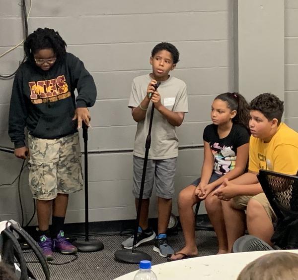 Mario Ferguson, 11, takes his turn at the mic