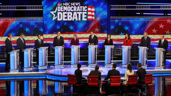 Democratic presidential candidates take the stage during the first night of the debate in Miami. The contenders want to see who can be the most generous when it comes to alleviating higher education costs.