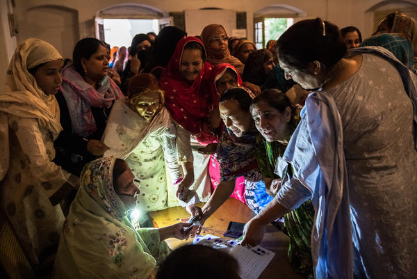 Pakistani women jostle to receive their ballot papers prior to casting their ballot at a polling station on May 11, 2013 in Lahore. A study in <em>The Lancet</em> provides evidence that free and fair elections are associated with a lower burden of chronic diseases.
