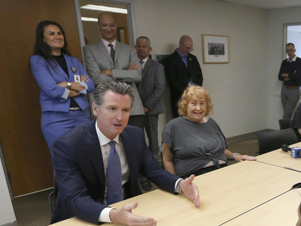 Gov. Gavin Newsom (left) talks with members of a Diabetes Talking Circle during his visit to the Sacramento Native American Health Center in Sacramento, Calif., on Tuesday.