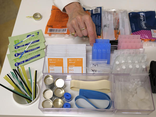 Supplies sit on a check-in desk at a model of a hypothetical injection site in San Francisco, pictured here in September 2018. Local leaders from San Francisco are among a dozen local officials urging a federal court to allow an effort to open a supervised injection site in Philadelphia.