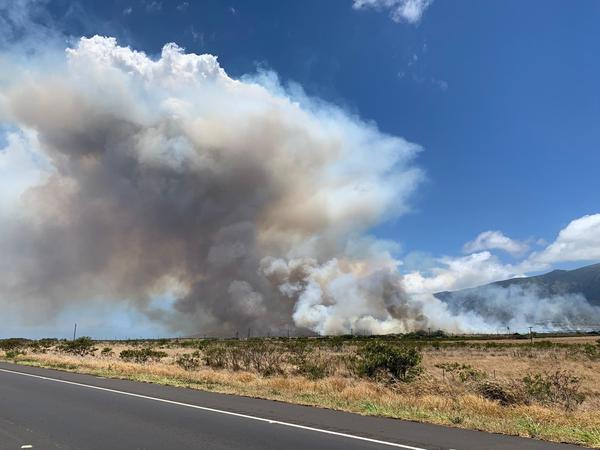 A brush fire that erupted over fallow land Thursday morning in Maui caused thousands of people to be evacuated and temporarily disrupted the island's primary airport.
