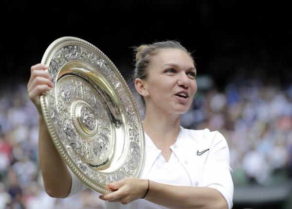 Romania's Simona Halep holds the trophy after defeating United States' Serena Williams during the women's singles final match on day 12 of the Wimbledon Tennis Championships in London on Saturday.
