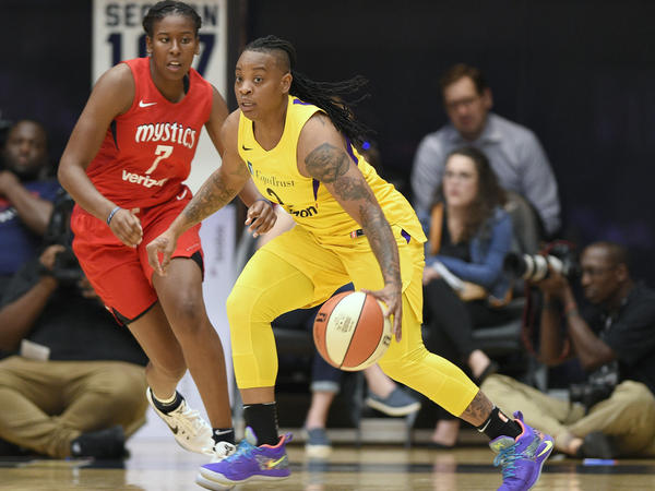 Los Angeles Sparks guard Riquna Williams (right) dribbles in a playoff game against the Washington Mystics last year.