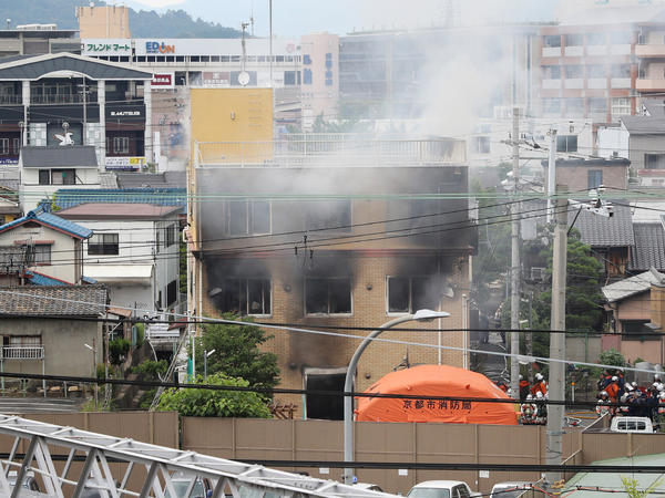 Smoke rises from an animation company building after a fire in Kyoto, Japan, on Thursday.