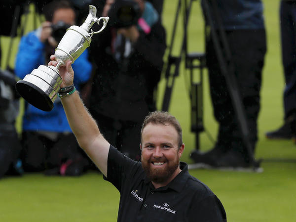 Shane Lowry of Ireland celebrates with the Claret Jug during the final round of the British Open held at Royal Portrush Golf Club, just a few hours from where he grew up.