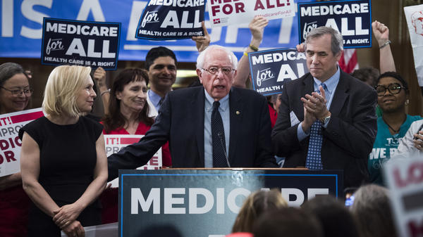 """Sens. Kirsten Gillibrand, Bernie Sanders and Jeff Merkley hold an event to introduce the """"Medicare for All Act of 2019"""" near the U.S Capitol in April."""