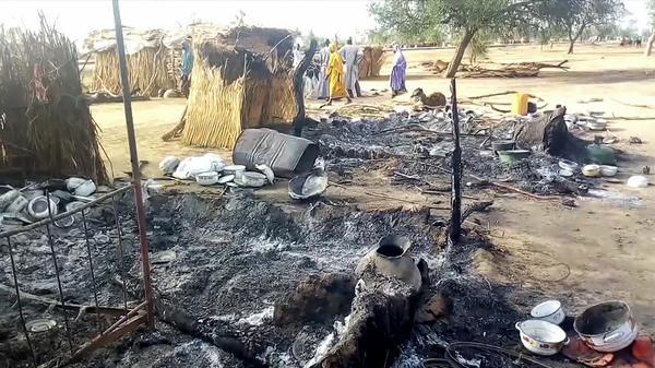 Ashes smolder on the ground in the northeast Nigerian village of Budu on Sunday, after an attack this weekend by suspected Boko Haram fighters on a funeral procession left 60 people dead.