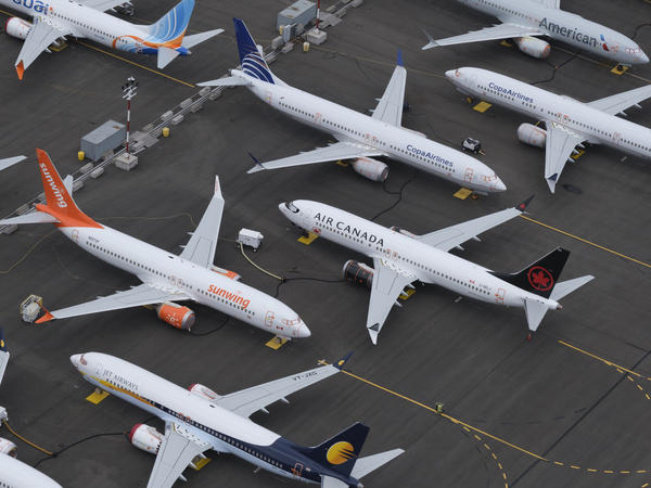 Boeing 737 Max airplanes are stored in an area adjacent to Boeing Field last month in Seattle. Airlines around the world are cutting flights because of the grounding of the plane.
