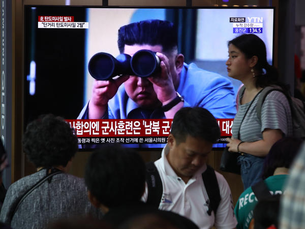 South Koreans in Seoul watch a file image of North Korean leader Kim Jong Un observing a missile launch after Pyongyang's latest test was announced on Wednesday.