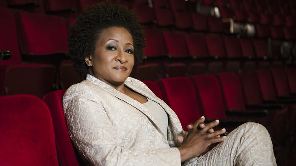 "Wanda Sykes surprised herself by coming out publicly as a lesbian at a 2008 LGBTQ rally in Las Vegas. ""I didn't even know that I was going to do it,"" she says. ""It wasn't planned at all."""