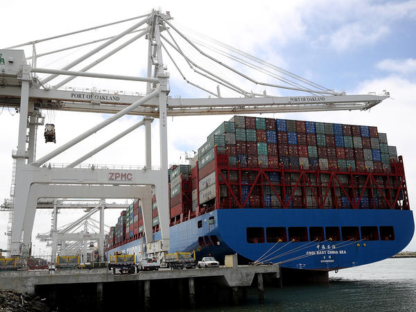 A container ship sits in a berth at the Port of Oakland in California last year. President Trump announced additional tariffs on imports from China on Thursday.