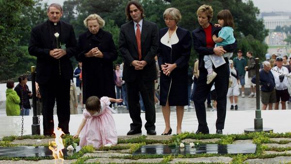 Robert F. Kennedy's granddaughter, Saoirse Kennedy Hill, places a flower at the Eternal Flame, President John F. Kennedy's gravesite in Arlington, Va., in 2000. Hill died Thursday at age 22.