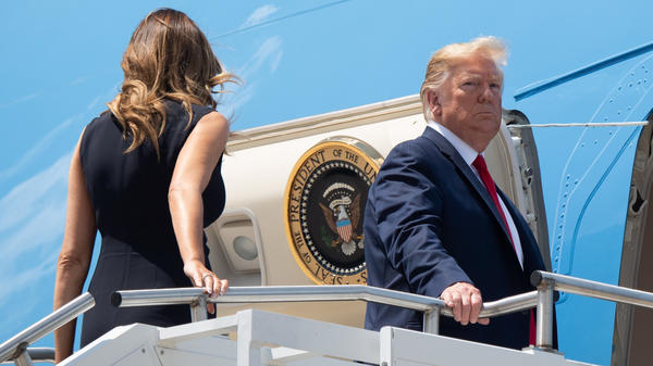 President Trump boards Air Force One in Ohio as he departs for Texas to meet with victims of the mass shooting in El Paso.