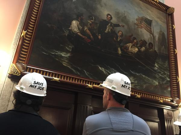 """FirstEnergy Solutions nuclear plant workers visit the Statehouse with the message """"Save Our Jobs"""" written on their hardhats."""