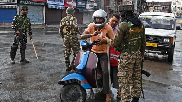 Indian security forces check the identity of a motorist in Srinagar, in Indian-controlled Kashmir, on Thursday.