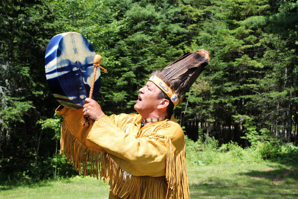 Dwayne Tomah, the youngest fluent Passamaquoddy speaker, sings a Passamaquoddy song outside of his home in Perry, Maine. Tomah is translating and interpreting songs and stories from wax cylinders recorded nearly 130 years ago.