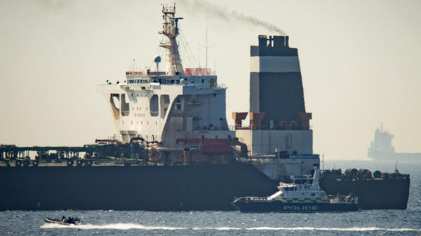 A Royal Marine patrol vessel is seen beside Iran's Grace 1 tanker in the British territory of Gibraltar on July 4. The tanker was impounded, and the U.S. Justice Department applied to seize it, according to the Gibraltar government.