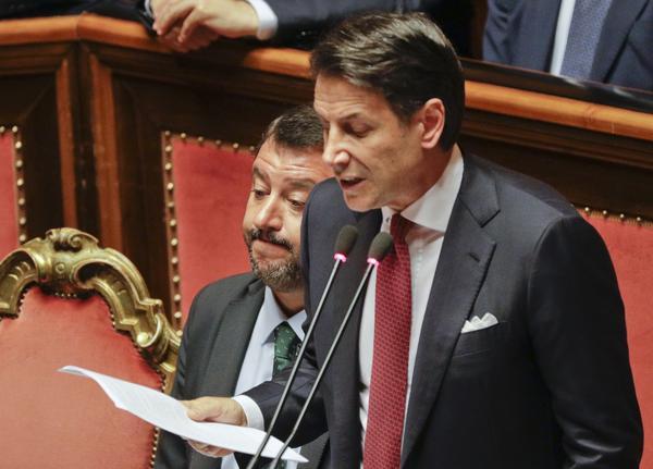 Italian Premier Giuseppe Conte (right) speaks to the Senate on Tuesday next to Deputy Premier Matteo Salvini.