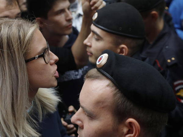 Russian opposition candidate and lawyer Lyubov Sobol stands in front of police during a demonstration in Moscow on July 14. This summer's wave of opposition protests has pushed Sobol to the forefront of the Russian political scene.