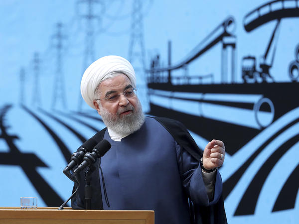 In a photo released by the official website of the office of the Iranian presidency, President Hassan Rouhani speaks at a conference in Tehran on Monday.