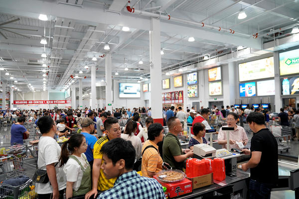 Crowds streamed into the new Costco location, which opened on Tuesday in Shanghai.