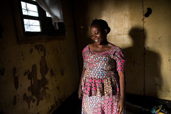 Esperance Nabintu, 42, an Ebola survivor, photographed on Aug. 15 in Goma. One of her children also contracted the disease and survived. But her husband, Rene Daniele Fataki, died from the disease. This photo was taken as friends and family gathered at her home to mourn and to celebrate his life.