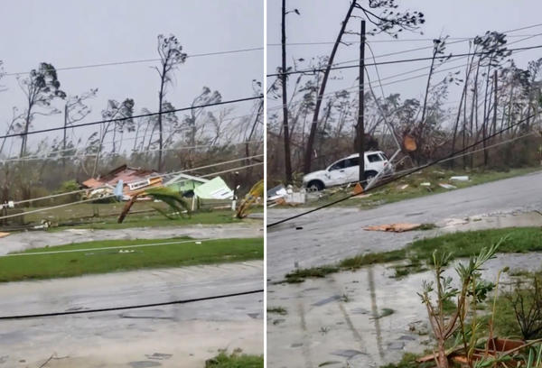 Uprooted trees, fallen power lines and the debris from damaged houses are scattered on a road as Hurricane Dorian sweeps through Marsh Harbour, Bahamas.