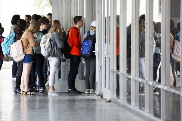 Voters line up on UT Austin campus to cast ballots in the midterm elections last year.
