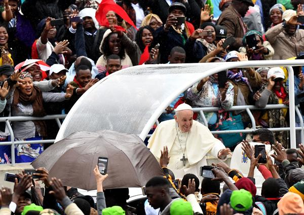 Pope Francis waves as he arrives at Zimpeto Stadium in Maputo, Mozambique, on Thursday, where he led a public Mass.