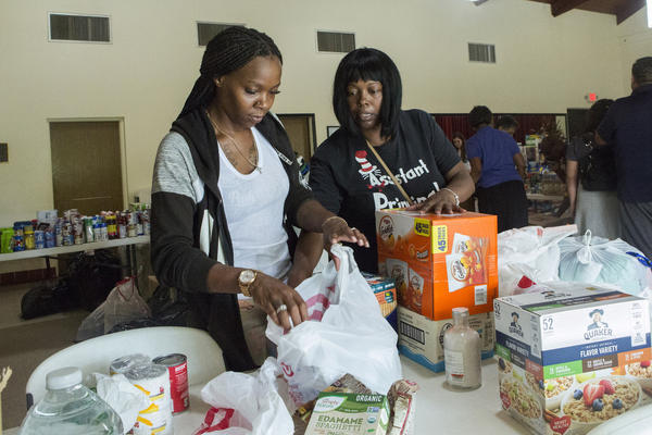 Volunteers Jazz Williams, 29, left, and Jodye Scavella, 47, organize donated goods for those affected by Hurricane Dorian in the Bahamas, at Christ Episcopal Church in Miami, Tuesday, Sept. 3, 2019.