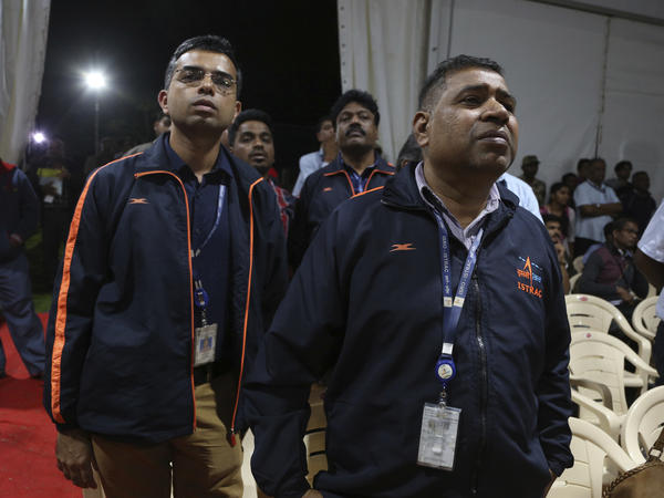 Indian Space Research Organization employees react as they learn that mission control lost communication with its unmanned landing module moments before it touched down on the moon's south pole Saturday (local time.)