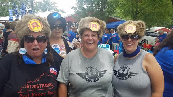 """The August heat at a political event did not deter (from left) Laura Hartke, Christina Trosper and Katie Hancock from wearing their Russian-styled fur hat with buttons saying: """"Say Nyet To Moscow Mitch."""""""