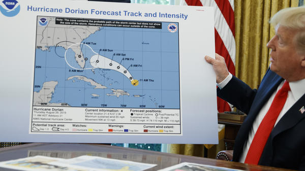 President Trump holds an altered chart as he talks with reporters after receiving a briefing on Hurricane Dorian in the Oval Office of the White House, on Wednesday in Washington.