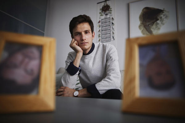 Omar Alshogre, a Syrian refugee who was tortured as a political prisoner in Syria, now lives in Sweden. He has framed photos of men who he says tortured him that he keeps upside down.