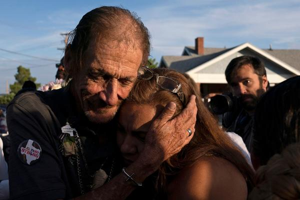 Antonio Basco, husband of El Paso Walmart shooting victim Margie Reckard, hugs an attendee during his wife's visitation service in El Paso, Texas, in August.