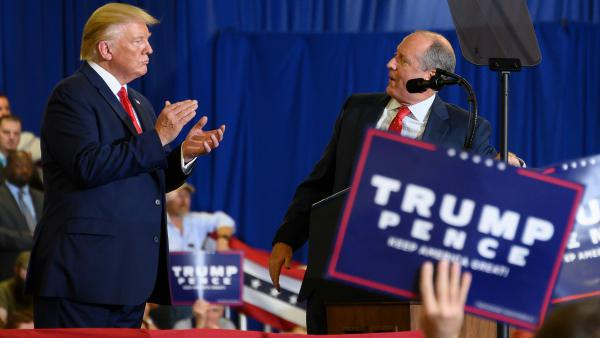 President Trump on stage with Republican candidate Dan Bishop during a campaign rally in Fayetteville, N.C., on Monday. The do-over congressional election may test whether reliably Republican suburban voters are still loyal.