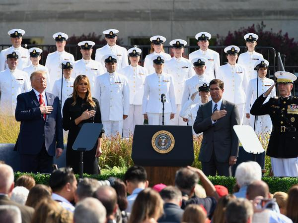 President Trump and first lady Melania Trump listen to the national anthem during a ceremony marking the 18th anniversary of the Sept. 11 attacks at the Pentagon earlier this week.