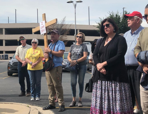 A few dozen anti-abortion activists gathered outside the coroner's office in Will County, Ill., on Thursday, to pray and call for formal burial of the remains.