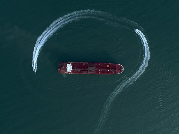 Speedboats from Iran's Revolutionary Guard circle the British-flagged oil tanker Stena Impero on Sunday, July 21 in the Iranian port of Bandar Abbas, after it was seized in the Strait of Hormuz two days earlier.
