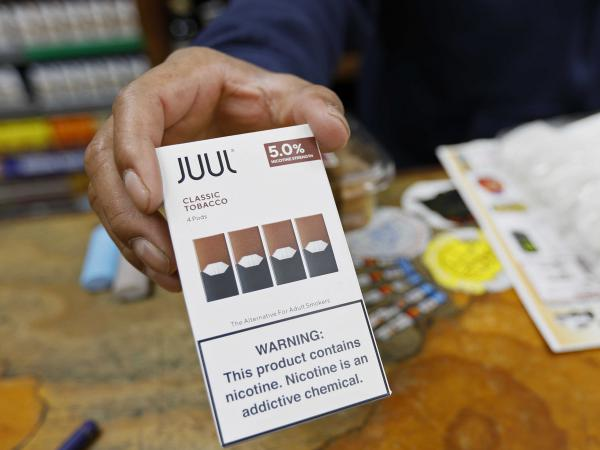 Juul announced that its CEO is stepping down and the company will stop advertising its popular vaping products. The announcements come as regulators work on new rules to curb the use of flavored vaping products among young adults.