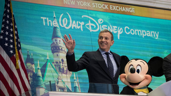 Bob Iger, CEO and chairman of The Walt Disney Co., and Mickey Mouse rang the opening bell at the New York Stock Exchange in November 2017. Iger's new book is an account of what he has learned running Disney.