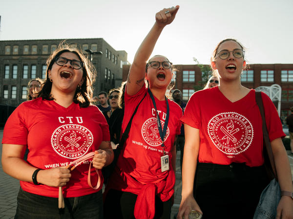 Chicago Teachers Union members cheer at a rally ahead of a potential strike.