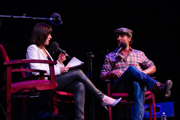 Host Ophira Eisenberg chats with Matthew McConaughey on <em>Ask Me Another</em> at the Paramount Theatre in Austin, Texas.