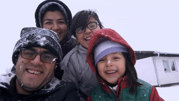Afghan filmmaker Hassan Fazili (bottom left) and his wife, filmmaker Fatima Hussaini (top left), with their daughters, Nargis (top right) and Zahra.