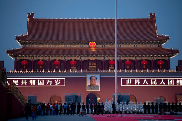 Chinese honor guards stand in formation during the lowering of the national flag in front of Tiananmen Gate in Beijing on Monday, one day before the 70th anniversary of the founding of the People's Republic of China.