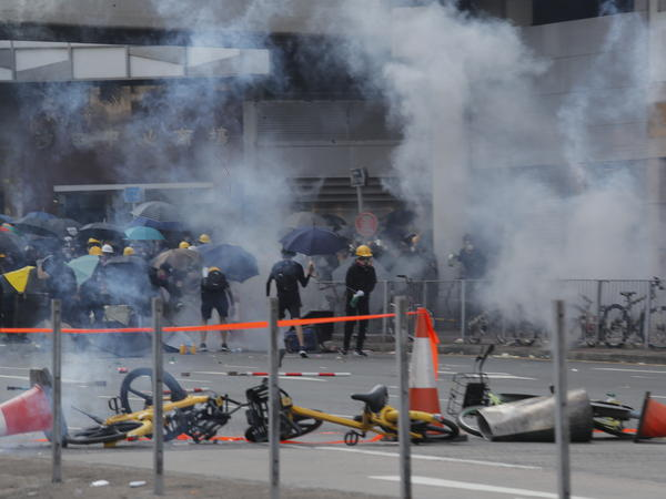 Police fire tear gas at anti-government protesters at Sha Tin, Hong Kong, on Tuesday.
